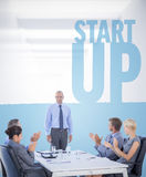 Composite image of business people applauding during meeting. Business people applauding during meeting  against start up Stock Image