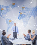 Composite image of business people applauding during meeting. Business people applauding during meeting  against world map Royalty Free Stock Photos