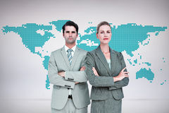 Composite image of business people with arms crossed looking at camera Royalty Free Stock Photography