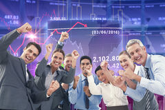 Composite image of business people cheering in office Royalty Free Stock Images