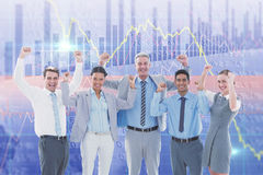 Composite image of business people cheering in office Stock Images