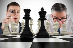 Composite image of business people with chessboard Royalty Free Stock Image
