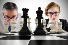 Composite image of business people and chessboard Royalty Free Stock Photo
