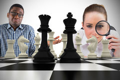 Composite image of business people with chessboard Royalty Free Stock Images