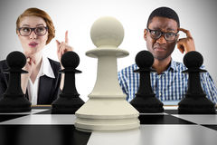 Composite image of business people with chessboard Stock Photos