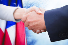 Composite image of business people doing handshake Royalty Free Stock Photography
