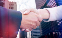 Composite image of business people doing handshake Royalty Free Stock Image