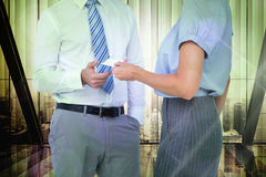Composite image of business people exchanging business card Stock Image
