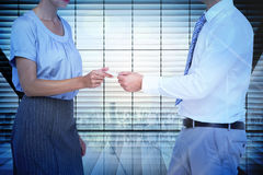 Composite image of business people exchanging business card Stock Photo