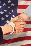 Composite image of business people in handcuffs shaking hands Royalty Free Stock Photo