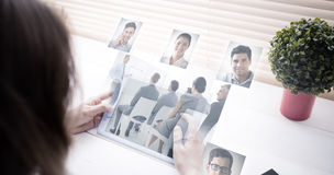 Composite image of business people having a meeting Royalty Free Stock Image