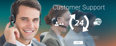 Composite image of business people with headsets using computers. Business people with headsets using computers  against orange and turquoise background Royalty Free Stock Photo