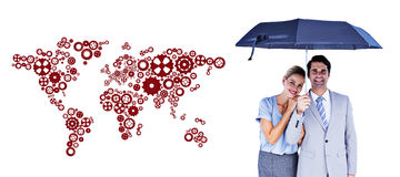 Composite image of business people holding a black umbrella Stock Photos