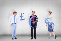Composite image of business people holding cogs Stock Photo