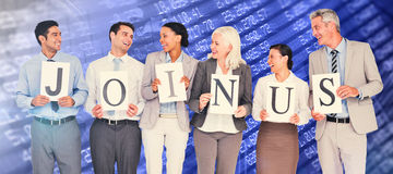Composite image of business people holding letters sign Royalty Free Stock Photos