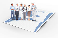 Composite image of business people holding letters sign Royalty Free Stock Images