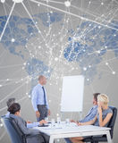 Composite image of business people listening during meeting Stock Image