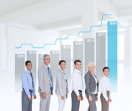 Composite image of business people looking at camera Stock Images