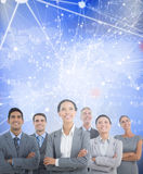 Composite image of business people looking up in office Stock Image