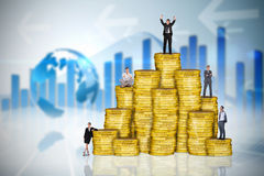 Composite image of business people on pile of coins Royalty Free Stock Photos