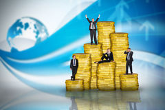 Composite image of business people on pile of coins Stock Image