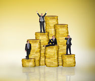 Composite image of business people on pile of coins Royalty Free Stock Image