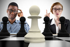 Composite image of business people playing chess Stock Photo