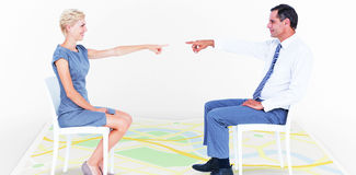 Composite image of business people pointing at each other Royalty Free Stock Photo