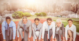 Composite image of business people preparing to run Royalty Free Stock Photo