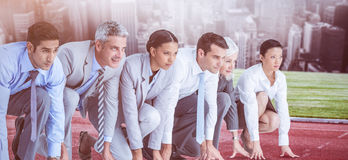 Composite image of business people preparing to run Royalty Free Stock Photography