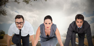 Composite image of business people ready to start race Stock Images
