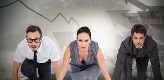 Composite image of business people ready to start race Stock Photography