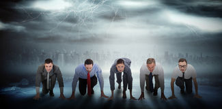 Composite image of business people ready to start race Royalty Free Stock Image