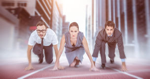 Composite image of business people ready to start race Stock Image