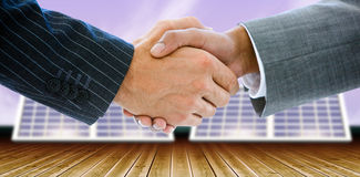 Composite image of business people shaking hands. Business people shaking hands against blue sky Royalty Free Stock Images