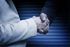 Composite image of business people shaking hands Royalty Free Stock Photos