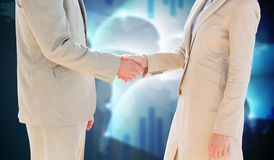 Composite image of business people shaking hands Stock Image