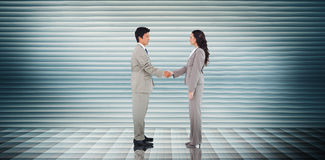 Composite image of business people shaking hands Stock Photos