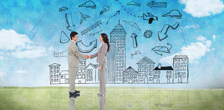 Composite image of business people shaking hands Royalty Free Stock Photography