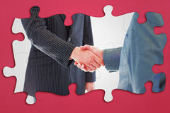 Composite image of business people shaking hands Royalty Free Stock Image
