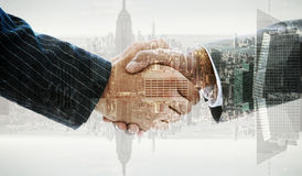 Composite image of business people shaking hands Stock Photography