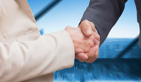 Composite image of business people shaking hands Royalty Free Stock Images