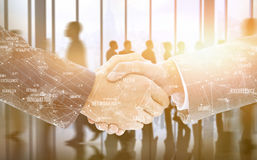 Composite image of business people shaking hands Stock Images