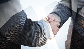 Composite image of business people shaking hands close up Stock Photos