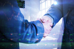 Composite image of business people shaking hands close up Royalty Free Stock Photo