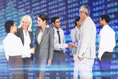 Composite image of business people speaking together Stock Image