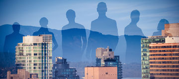 Composite image of business people standing against white background. Business people standing against white background against buildings in city against blue Stock Photography