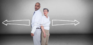 Composite image of business people standing back to back Royalty Free Stock Photo