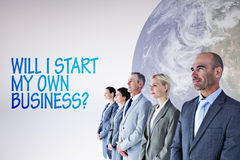 Composite image of business people standing in a row Stock Image