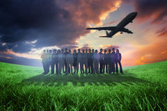 Composite image of business people standing up with airplane Royalty Free Stock Photos